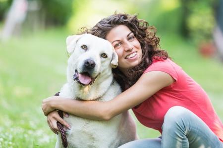 Labrador Retriever and their owner